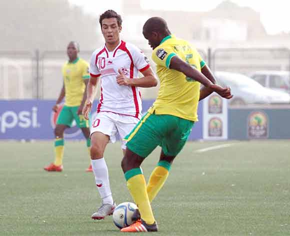 Ilyes Jelassi of Tunisia challenges Ishmael Mngonyama of South Africa during the U23 African Cup of Nations match between South Africa and Tunisia at Caroline Faye Stadium,Mbour on 04th December 2015 ©/BackpagePix
