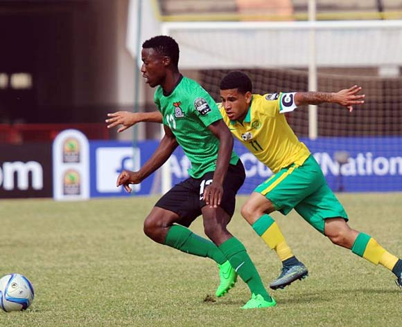 Benson Sakala of Zambia and Keagan Dolly of South Africa during the U 23 African Cup of Nations match between South Africa and Zambia at Stade Leopold Stadium,Senegal on the 01 December 2015 ©/BackpagePix