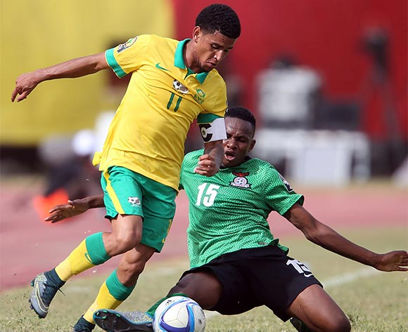 Keagan Dolly of South Africa challenged by  Paul Katema of Zambia during the U 23 African Cup of Nations match between South Africa and Zambia at Stade Leopold Stadium,Senegal on the 01 December 2015 ©/BackpagePix