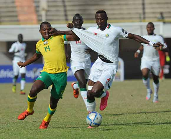 Gift Motupa of Soutf Africa challenged by Ibrahima Diedhiou of Senegal during the U23 African Cup of Nations match between South Africa and Senegal on the 12ve December 2015 at Stade Leopold Sedar Senghor in Dakar ©/BackpagePix
