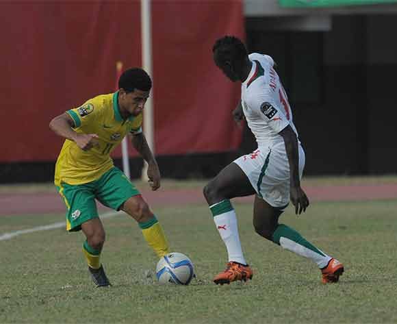Keagan Dolly of South Africa challenged by Adama Mbengue of Senegal during the U23 African Cup of Nations match between South Africa and Senegal on the 12ve December 2015 at Stade Leopold Sedar Senghor in Dakar ©/BackpagePix