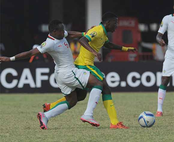 Boubacar Cissokho of Senegal challenges Phumlani Nkosinathi Ntshangase of South Africa during the U23 African Cup of Nations match between South Africa and Senegal on the 12ve December 2015 at Stade Leopold Sedar Senghor in Dakar ©/BackpagePix
