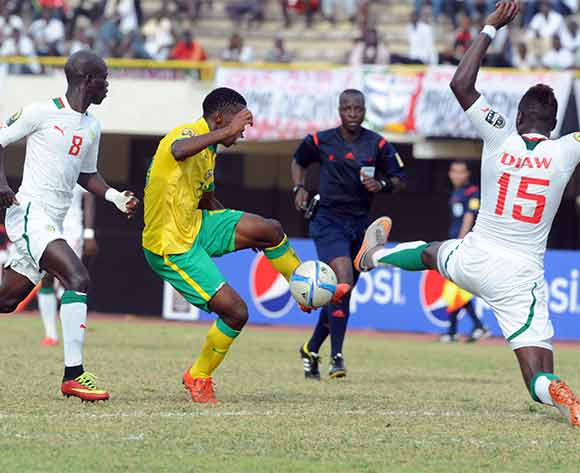 Boubacar Cissokho and Elhadji Pape Djibril Diaw both of Senegal challenges Phumlani Nkosinathi Ntshangase of South Africa during the U23 African Cup of Nations match between South Africa and Senegal on the 12ve December 2015 at Stade Leopold Sedar Senghor in Dakar ©/BackpagePix