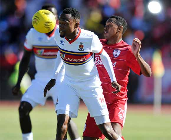 Thabo Mnyamane of University of Pretoria battles with Reuben Thebakang of Free State Stars during the Absa Premiership 2015/16 match between Free State Stars and University of Pretoria at Goble Park, Bethlehem on the 13 December 2015