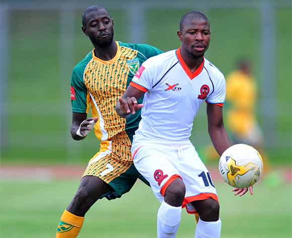Puleng Tlolane of Polokwane City challenged by Deon Hotto of Golden Arrows during the Absa Premiership 2015/16 match between Golden Arrows v Polokwane City at Chatsworth Stadium, Durban on the 19 December 2015 ©Muzi Ntombela/BackpagePix