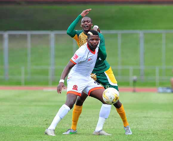 Sphesihle Nzimande of Polokwane City challenged by Nkanyiso Cele of Golden Arrows during the Absa Premiership 2015/16 match between Golden Arrows v Polokwane City at Chatsworth Stadium, Durban on the 19 December 2015