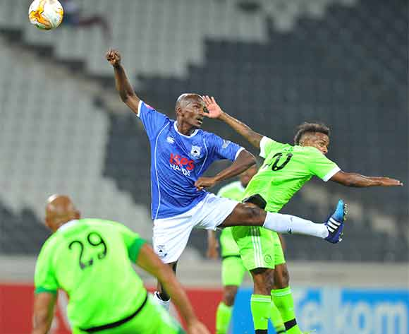 Erwin Issacs of Ajax Cape Town challenged by Lehlohonolo Nonyane of Black Aces during the Absa Premiership match between Black Aces and Ajax Cape Town at the Mbombela Stadium in Nelpruit, South Africa on December 19, 2015 ©Samuel Shivambu/BackpagePix