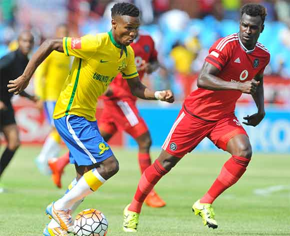 Themba Zwane of Mamelodi Sundowns challenged by Edwin Gyimah of Orlando Pirates  during the Absa Premiership match between Mamelodi Sundowns and Orlando Pirates at the Loftus Stadium in Pretoria, South Africa on December 20, 2015 ©Samuel Shivambu/BackpagePix
