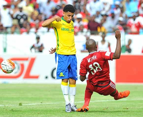 Keagan Dolly of Mamelodi Sundowns tackled by Gift Motupa of Orlando Pirates during the Absa Premiership match between Mamelodi Sundowns and Orlando Pirates at the Loftus Stadium in Pretoria, South Africa on December 20, 2015 ©Samuel Shivambu/BackpagePix