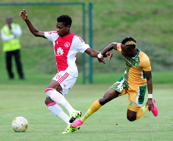 Lawrence Lartey of Ajax Cape Town challenged by Kudakwashe Mahachi of Golden Arrows during the Absa Premiership match between Lamontville GoldenArrows FC v Ajax Cape Town F.C. at the King Zwelithini Stadium in Umlazi, Durban, South Africa on January 13, 2016 ©Gerhard Duraan/BackpagePix