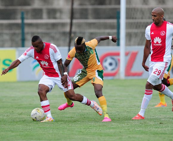 Nathan Paulse of Ajax Cape Town F.C. watches Franklin Cale of Ajax Cape Town challenged by Kudakwashe Mahachi of Golden Arrows battle for the ball during the Absa Premiership match between Lamontville GoldenArrows FC v Ajax Cape Town F.C. at the King Zwelithini Stadium in Umlazi, Durban, South Africa on January 13, 2016 ©Gerhard Duraan/BackpagePix