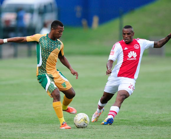 Thembela Sikhakhane of Golden Arrows challenged by Franklin Cale of Ajax Cape Town during the Absa Premiership match between Lamontville GoldenArrows FC v Ajax Cape Town F.C. at the King Zwelithini Stadium in Umlazi, Durban, South Africa on January 13, 2016 ©Gerhard Duraan/BackpagePix
