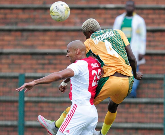 Chris Katjiukua of Golden Arrows got the better of Nathan Paulse of Ajax Cape Town during the Absa Premiership match between Lamontville GoldenArrows FC v Ajax Cape Town F.C. at the King Zwelithini Stadium in Umlazi, Durban, South Africa on January 13, 2016 ©Gerhard Duraan/BackpagePix