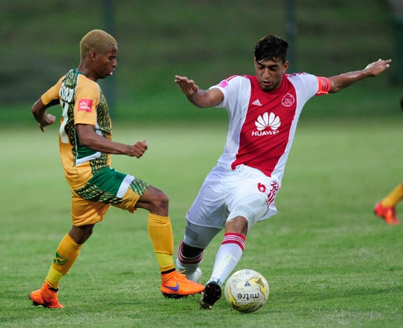 Andile Fikizolo of Golden Arrows  tries to stop Travis Graham (Captain) of Ajax Cape Town during the Absa Premiership match between Lamontville GoldenArrows FC v Ajax Cape Town F.C. at the King Zwelithini Stadium in Umlazi, Durban, South Africa on January 13, 2016 ©Gerhard Duraan/BackpagePix