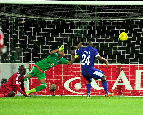 Mondili Cele of Maritzburg United plants this one in the net past Brighton Mhlongo of Orlando Pirates during the Absa Premiership match between Maritzburg United and Orlando Pirates at the Harry Gwala Stadium in Pietermaritzburg South Africa on Jan 16, 2016 ©Gerhard Duraan/BackpagePix