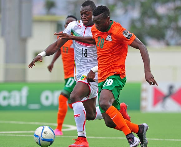 Patson Daka of Zambia is challenged by Aliou Dieng of Mali