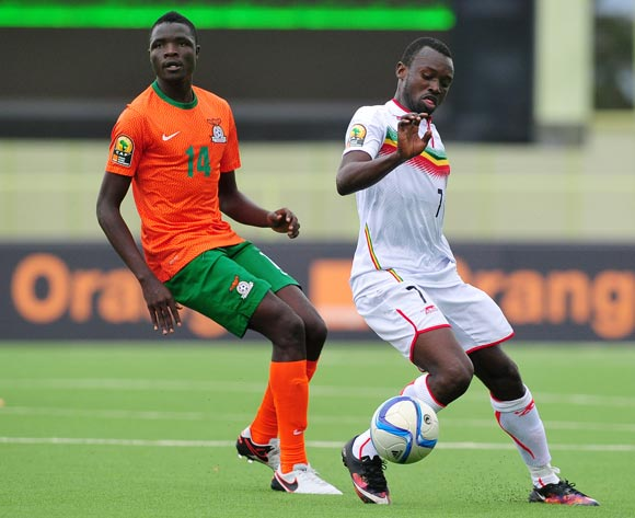 Abdoul Toure of Mali controls as he is challenged by Jack Chirwa of Zambia
