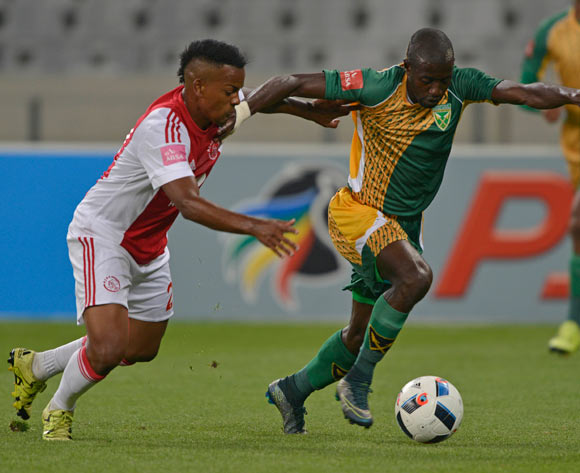 Deon Hotto of Golden Arrows evades challenge from Erwin Isaacs of Ajax Cape Town during the Absa Premiership 2015/16 football match between Ajax Cape Town and Golden Arrows at Cape Town Stadium, Cape Town on 29 January 2016 ©Chris Ricco/BackpagePix