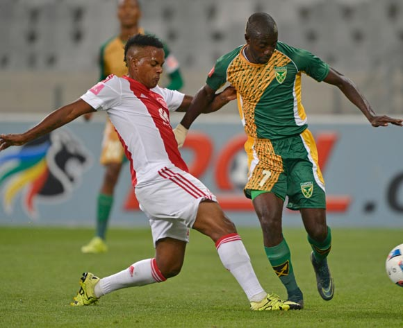 Deon Hotto of Golden Arrows tackled by Erwin Isaacs of Ajax Cape Town during the Absa Premiership 2015/16 football match between Ajax Cape Town and Golden Arrows at Cape Town Stadium, Cape Town on 29 January 2016 ©Chris Ricco/BackpagePix