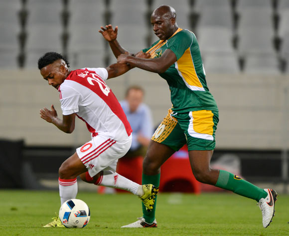 Erwin Isaacs of Ajax Cape Town tackled by Musa Bilankulu of Golden Arrows during the Absa Premiership 2015/16 football match between Ajax Cape Town and Golden Arrows at Cape Town Stadium, Cape Town on 29 January 2016 ©Chris Ricco/BackpagePix