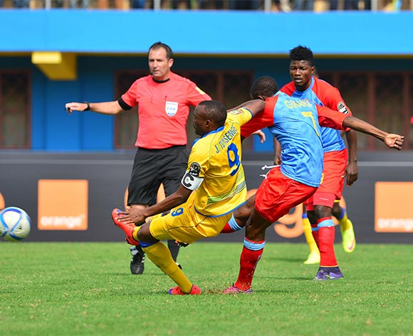 Doxa Gikanji of DR Congo scores goal despite tackle from Jacques Tuyisenge of Rwanda during the 2016 CHAN quarterfinal football match between Rwanda and DR Congo at the Amahoro Stadium in Kigali, Rwanda on 30 January 2016 ©Gavin Barker/BackpagePix