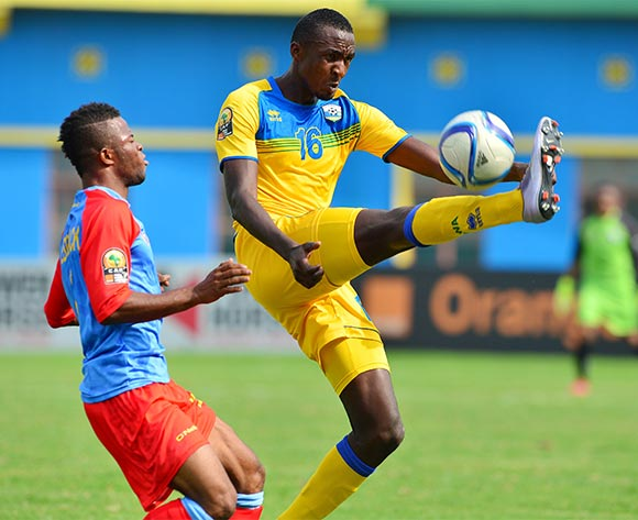 Ernest Sugira of Rwanda controls ball away from Meschack Elia of DR Congo  during the 2016 CHAN quarterfinal football match between Rwanda and DR Congo at the Amahoro Stadium in Kigali, Rwanda on 30 January 2016 ©Gavin Barker/BackpagePix