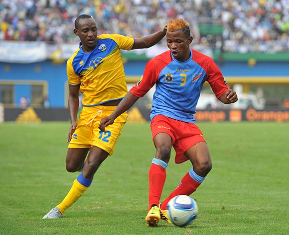 Lomalisa Mutambala of DR Congo challenged by Jean Claude Iranzi of Rwanda during the 2016 CHAN Rwanda, Quarterfinal match between Rwanda and DR Congo in Amahoro Stadium, Kigali, Rwanda on 30 January 2016 ©Muzi Ntombela/BackpagePix