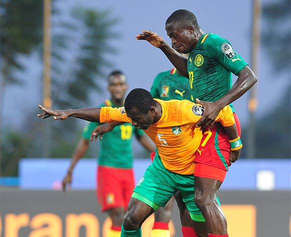 Beaudelaire Aka Essis of Ivory Coast is challenged by Stephan Mpondo Kingue of Cameroon during the 2016 CHAN Rwanda quarterfinal between Cameroon and Ivory Coast at Huye Stadium, Butare on 30 January 2016 ©Ryan Wilkisky/BackpagePix