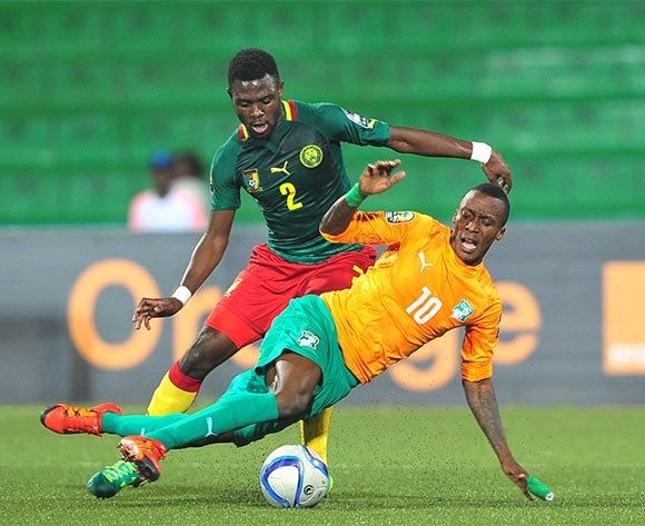 Krahire Yannick Zakri of Ivory Coast is fouled by Joseph Ngwem of Cameroon during the 2016 CHAN Rwanda quarterfinal between Cameroon and Ivory Coast at Huye Stadium, Butare on 30 January 2016 ©Ryan Wilkisky/BackpagePix