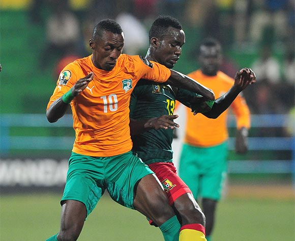 Krahire Yannick Zakri of Ivory Coast is challenged by Nicloas Brice Mouumi of Cameroon during the 2016 CHAN Rwanda quarterfinal between Cameroon and Ivory Coast at Huye Stadium, Butare on 30 January 2016 ©Ryan Wilkisky/BackpagePix