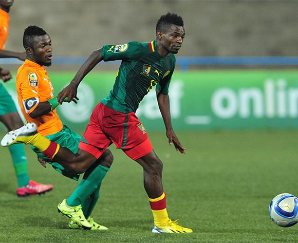 Emane Yazid Atouba of Cameroon takes on Yao Serge Nguessan of Ivory Coast during the 2016 CHAN Rwanda quarterfinal between Cameroon and Ivory Coast at Huye Stadium, Butare on 30 January 2016 ©Ryan Wilkisky/BackpagePix