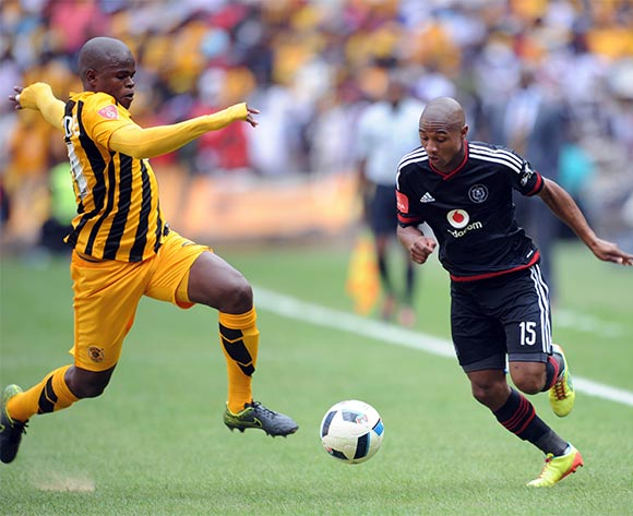 Willard Katsande of Kaizer Chiefs tackles Thabo Qalinge  of Orlando Pirates during the Absa Premiership match between Orlando Pirates and Kaizer Chiefs  on 30 January 2016 at Willowmoore Park  Pic Sydney Mahlangu/ BackpagePix