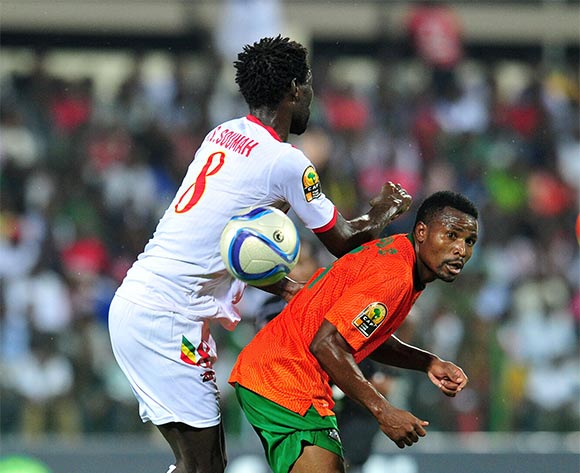 Christopher Katongo of Zambia challenged by Ibrahima Sory Soumah of Guinea during the 2016 CHAN Rwanda, Quarterfinal match between Zambia and Guinea in Rubavu Stadium Rubavu, Rwanda on 31 January 2016 ©Muzi Ntombela/BackpagePix