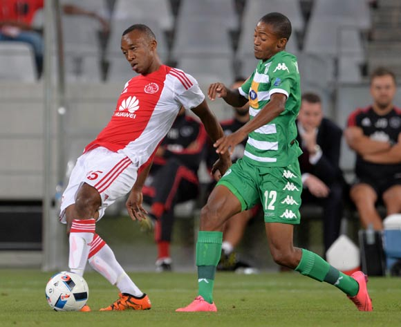 Milton Ncube of Ajax Cape Town tackled by Thapelo Morena of Bloemfontein Celtic during the Absa Premiership 2015/16 football match between Ajax Cape Town and Bloemfontein Celtic at Cape Town Stadium, Cape Town on 8 January 2016 ©Chris Ricco/BackpagePix