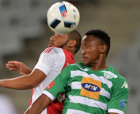 Thabang Matuka of Bloemfontein Celtic challenge for ball with Riyaad Norodien of Ajax Cape Town during the Absa Premiership 2015/16 football match between Ajax Cape Town and Bloemfontein Celtic at Cape Town Stadium, Cape Town on 8 January 2016 ©Chris Ricco/BackpagePix