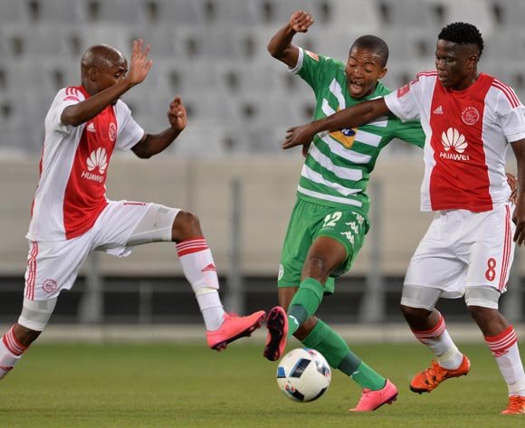 Thapelo Morena of Bloemfontein Celtic battles for the ball with Bantu Mzwakali of Ajax Cape Town (l) and Ndiviwe Mdabuka of Ajax Cape Town during the Absa Premiership 2015/16 football match between Ajax Cape Town and Bloemfontein Celtic at Cape Town Stadium, Cape Town on 8 January 2016 ©Chris Ricco/BackpagePix