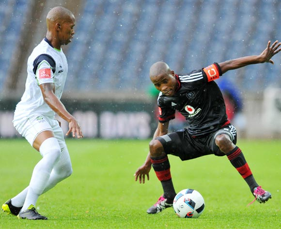 Thabo Matlaba of Orlando Pirates challenged by Vuyo Mere of Platinum Stars during the Absa Premiership match between Orlando Pirates and Platinum Stars at the Orlando Stadium in Johannesburg, South Africa on January 09, 2016 ©Samuel Shivambu/BackpagePix