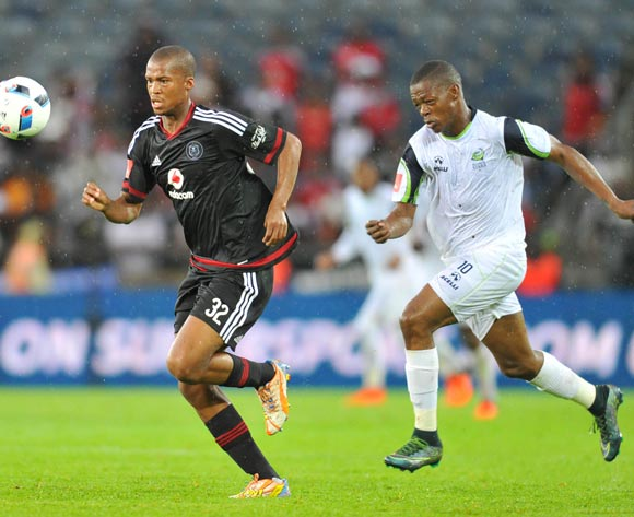 Tshepo Gumede of Orlando Pirates challenged by Ndumiso Mabena of Platinum Stars during the Absa Premiership match between Orlando Pirates and Platinum Stars at the Orlando Stadium in Johannesburg, South Africa on January 09, 2016 ©Samuel Shivambu/BackpagePix