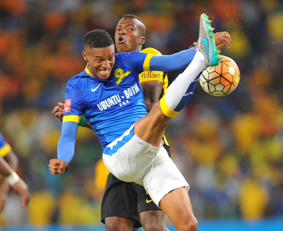 Thabo Nthethe of Mamelodi Sundowns challenged by Camaldine Abraw of Kaizer Chiefs during the Absa Premiership match between Kaizer Chiefs and Mamelodi Sundowns at the FNB Stadium in Johannesburg, South Africa on January 09, 2016 ©Samuel Shivambu/BackpagePix