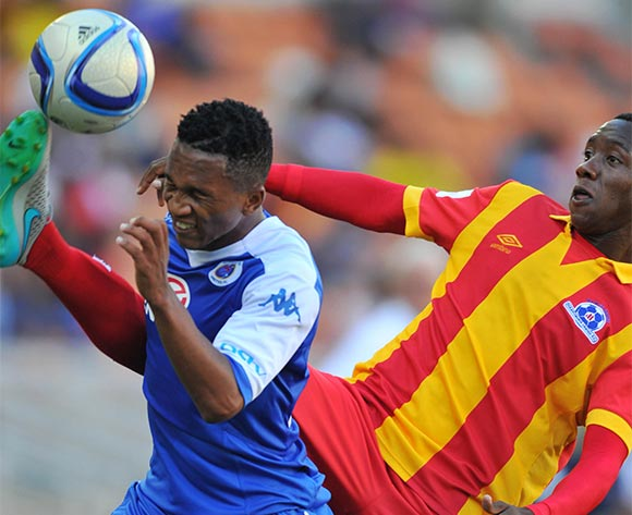 Luvolwethu Mpeta of Supersport United challenged by Evans Rusike of Maritzburg United during the Absa Premiership match between Supersport United and Maritzburg United at the Peter Mokaba Stadium in Limpopo, South Africa on January 10, 2016 ©Samuel Shivambu/BackpagePix