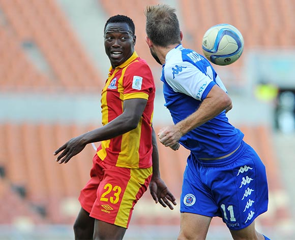Jeremy Brockie of Supersport United challenged by Philani Zulu of Maritzburg United during the Absa Premiership match between Supersport United and Maritzburg United at the Peter Mokaba Stadium in Limpopo, South Africa on January 10, 2016 ©Samuel Shivambu/BackpagePix