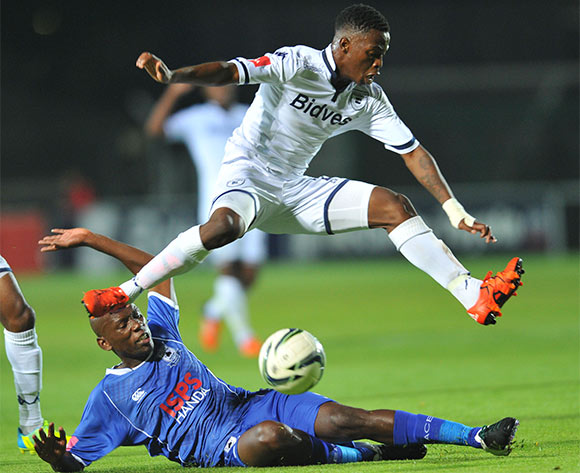 Phakamani Mahlaambi of Bidvest Wits tackled by Lehlohonolo Nonyane of Black Aces during the Absa Premiership match between Bidvest Wits and Black Aces at the Bidvest Stadium in Johannesburg, South Africa on January 15, 2016 ©Samuel Shivambu/BackpagePix