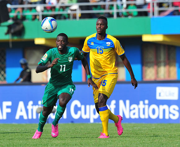 Davy Koffi Boua of Ivory Coast challenged by Faustin Usengimana of Rwanda during the 2016 CHAN football match between Rwanda and Ivory Coast  at the Amahoro Stadium in Kigali, Rwanda on 16 January 2016 ©Muzi Ntombela/BackpagePix