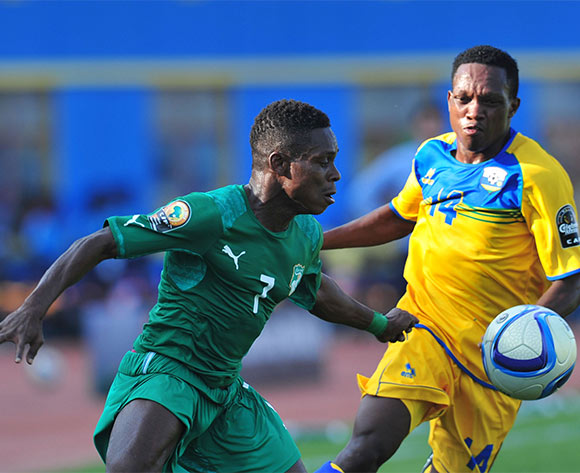 Marcellin Koffi of Ivory Coast challenged by Celestin Ndayishimiye of Rwanda during the 2016 CHAN football match between Rwanda and Ivory Coast  at the Amahoro Stadium in Kigali, Rwanda on 16 January 2016 ©Muzi Ntombela/BackpagePix