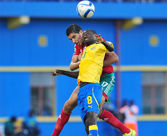 Romuald Ewouta Ntsitsigui of Gabon battles with Marouane Saadane of Morocco during the 2016 CHAN football match between Gabon and Morocco  at the Amahoro Stadium in Kigali, Rwanda on 16 January 2016 ©Muzi Ntombela/BackpagePix