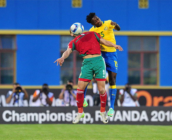 Abdesslam Benjelloun of Morocco battles with Prince Junior Ndinga of Gabon during the 2016 CHAN football match between Gabon and Morocco  at the Amahoro Stadium in Kigali, Rwanda on 16 January 2016 ©Muzi Ntombela/BackpagePix