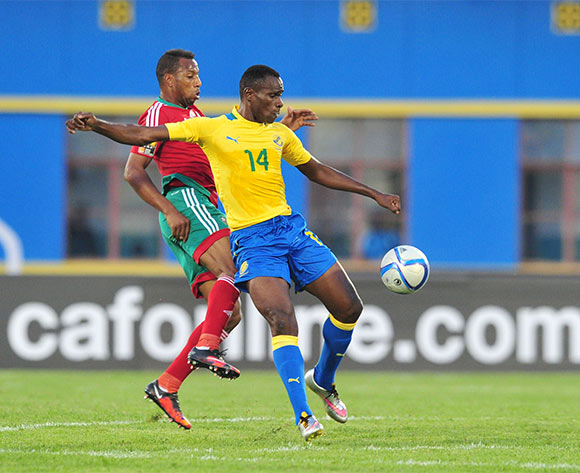 Cyrille Engozo Avebe of Gabon challenged by Brahim Nekkach of Morocco during the 2016 CHAN football match between Gabon and Morocco  at the Amahoro Stadium in Kigali, Rwanda on 16 January 2016 ©Muzi Ntombela/BackpagePix