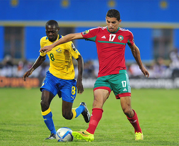 Marouane Saadane of Morocco challenged by Romuald Ewouta Ntsitsigui of Gabon during the 2016 CHAN football match between Gabon and Morocco  at the Amahoro Stadium in Kigali, Rwanda on 16 January 2016 ©Muzi Ntombela/BackpagePix