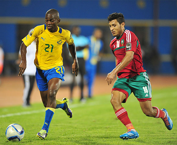 Christian Nze Ondo of Gabon challenged by Abdelilah Hafidi of Morocco during the 2016 CHAN football match between Gabon and Morocco  at the Amahoro Stadium in Kigali, Rwanda on 16 January 2016 ©Muzi Ntombela/BackpagePix