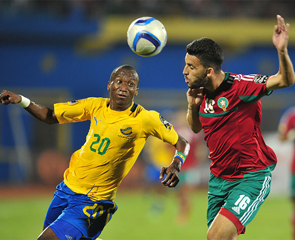 Mohamed Oulhaj of Morocco clears the ball from Lionel Yackouya of Gabon during the 2016 CHAN football match between Gabon and Morocco  at the Amahoro Stadium in Kigali, Rwanda on 16 January 2016 ©Muzi Ntombela/BackpagePix